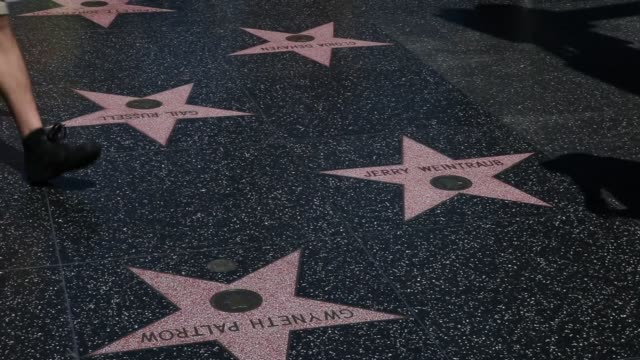 exterior shots of hollywood boulevards walk of fame stars and cement panels, tourists walk along the walk of fame path stepping over stars of john... - walk of fame stock videos & royalty-free footage