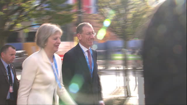 Exterior shots of Home Secretary Theresa May walking from the Midland Hotel to Manchester Central convention centre during the Conservative party...