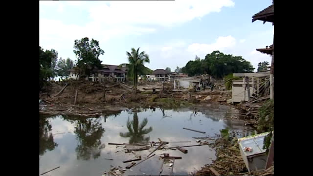 exterior shots of homes and buildings devastated by the tsunami with recovery workers searching and recovering bodies from amongst the wreckage>> on... - indian ocean stock videos & royalty-free footage
