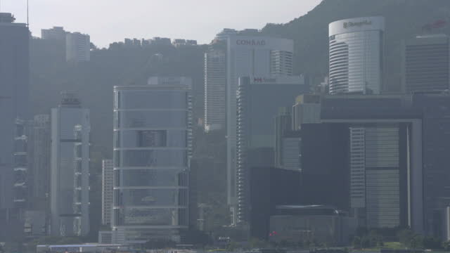Exterior shots of Hong Kong's city skyline including ships in the harbour ferries and tourists looking over the harbour area on January 15 2016 in...