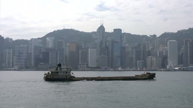 exterior shots of hong kong's city skyline including ships in the harbour, ferries and tourists looking over the harbour area on january 15, 2016 in... - victoria harbour hong kong stock videos & royalty-free footage
