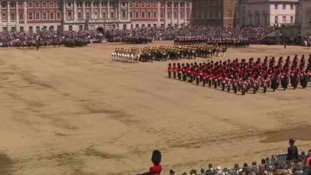 stockvideo's en b-roll-footage met exterior shots of horse guards riding past the saluting stand during the trooping of the colour ceremony including the household division the royal... - britse leger