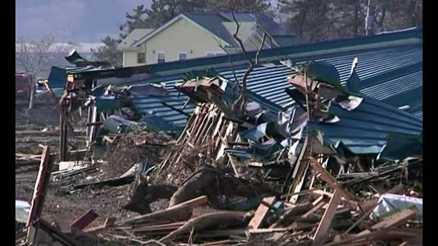 exterior shots of house debris and wooden timber from houses destroyed by tsunami and earthquake. exterior shots of cars and rubble laying on ground... - earthquake stock videos & royalty-free footage