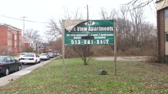 Exterior shots of housing developments in Cincinatti Ohio in fall on 1292014 Wide shot of a brown brick housing complex with a large dumpster Wide...