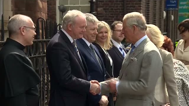 exterior shots of hrh prince charles and camilla duchess of cornwall arriving and greeted by sinn fein lord mayor of belfast arder carson first... - martin mcguinness stock videos and b-roll footage