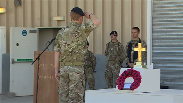vídeos de stock e filmes b-roll de exterior shots of hrh prince harry laying a wreath at a memorial service on november 9 2014 in kandahar afghanistan - kandahar