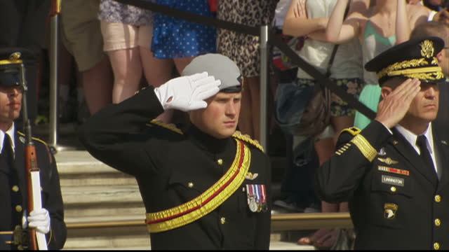Exterior shots of HRH Prince Harry of Wales salutes with US Army Major General Michael Linnington at a ceremonial wreath laying at the Tomb of the...