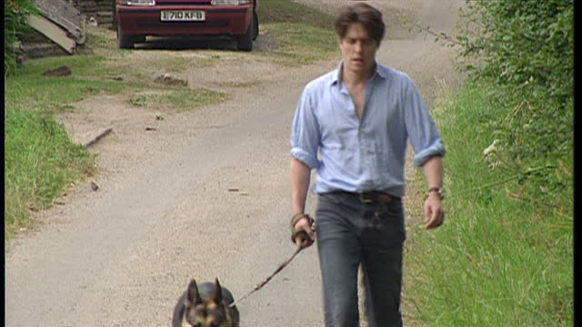 exterior shots of hugh grant walking with his dog and liz hurley walking with the same dog later on july 1 1995 in littleton south gloucestershire... - relationship breakup stock videos & royalty-free footage
