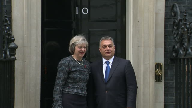 exterior shots of hungarian prime minister viktor orban arriving in a car before shaking hands with prime minister theresa may and posing for photos... - eastern european culture stock videos and b-roll footage
