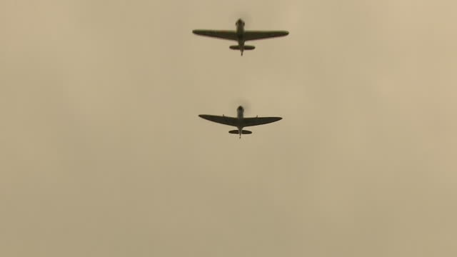 exterior shots of hurricane and spitfires flypast above the house of captain tome moore to mark his 100th birthday on 30 april 2020 in bedford united... - captain tom moore stock videos & royalty-free footage