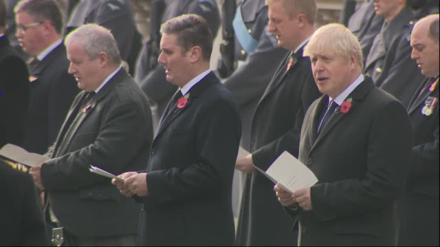 exterior shots of hymn being sung during remebrance sunday service at the cenotaph - prince charles, camilla, duchess of cornwall, catherine duchess... - remembrance sunday stock videos & royalty-free footage