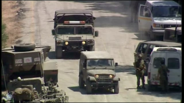 exterior shots of idf troops tanks and military vehicles gathered on the lebanese border with distant explosions audiable as israeli military... - 2006 stock videos & royalty-free footage