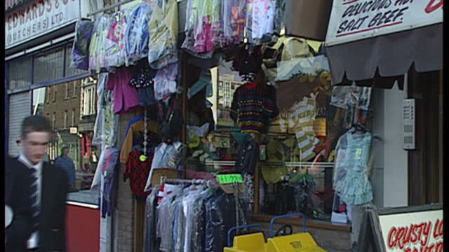 exterior shots of independent shops and wholesalers along brick lane and a sign for shoreditch tube station on october 25 1990 in london england - market stall stock videos & royalty-free footage
