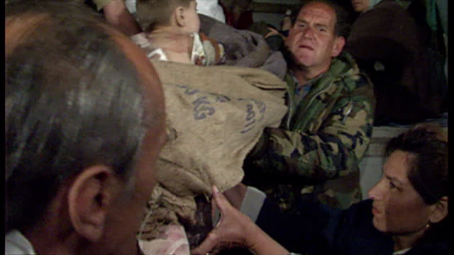 exterior shots of injured refugee children being unloaded by unhcr medics and troops on arrival at tuzla hospital on april 13, 1993 in srebrenica,... - bosnian war stock videos & royalty-free footage