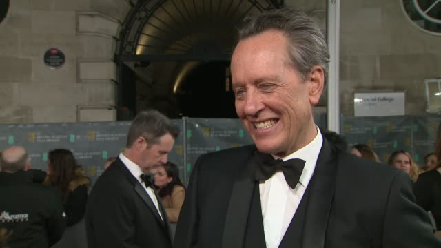 exterior shots of interview of richard e. grant on the baftas red carpet on 2nd february 2020 in london, england. - richard e. grant stock videos & royalty-free footage