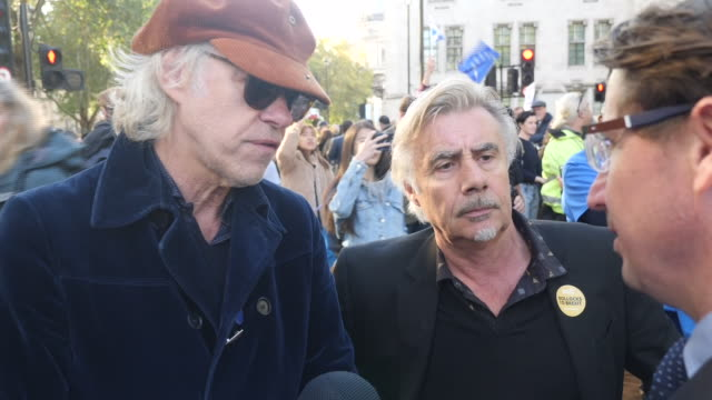 stockvideo's en b-roll-footage met exterior shots of interview with bob geldof and glen matlock at peoples vote march on 19 october 2019 in central london - bob geldof