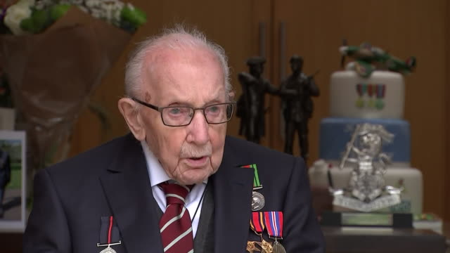 exterior shots of interview with captain tom moore on the day of his 100th birthday on 30 april 2020 in bedford, united kingdom. - number 100 stock videos & royalty-free footage