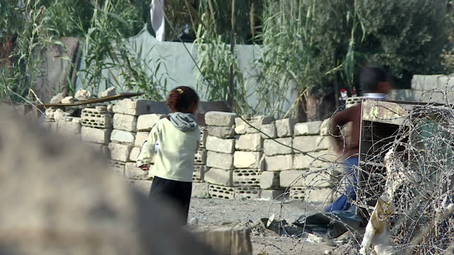 exterior shots of iraqi children playing amid rubble smiling after the withdrawal of isis from mosul on november 14 2016 in mosul iraq - schutt stock-videos und b-roll-filmmaterial