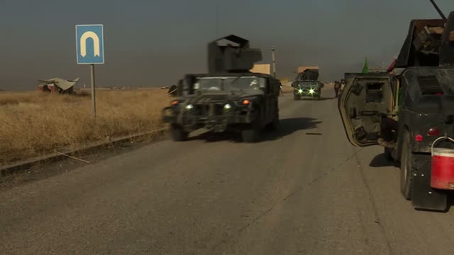 Exterior shots of Iraqi Golden Division army humvees by roadside during an assault on ISIS positions on October 23 2016 in Mosul Iraq