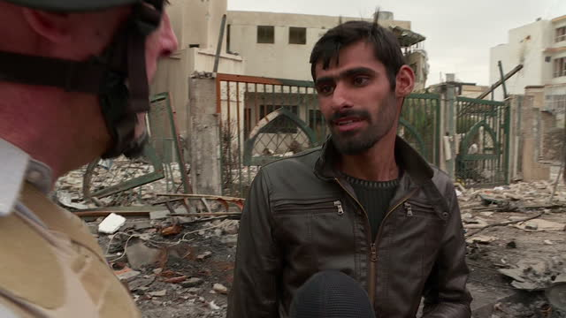 exterior shots of iraqi military helicopter flying over mosul interview with local resident who is a veterinary sudent who lived through islamic... - military invasion stock videos & royalty-free footage