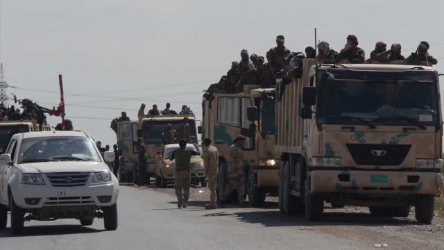 exterior shots of iraqi military troops iraqi shia troops from the badr army militia celebrating together after taking back control of tikrit from... - home guard britannica video stock e b–roll