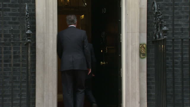 exterior shots of irish president michael d higgins arriving at no 10 downing street and greeted by british prime minister who pose for photo op... - michael d. higgins stock videos and b-roll footage