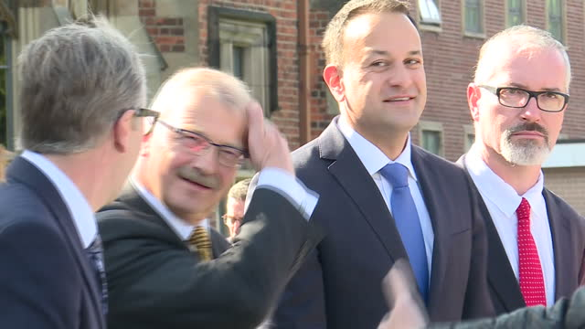 exterior shots of irish taoiseach leo varadkar arriving at queen's university in belfast and greeting various officials including professor james... - leo varadkar stock videos and b-roll footage