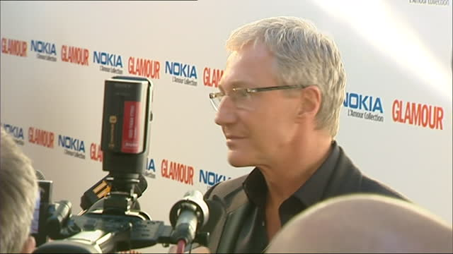 exterior shots of irish-english comedian and television presenter paul o'grady on the red carpet of the 2007 glamour magazine awards and speaking to... - irish film and television awards stock videos & royalty-free footage