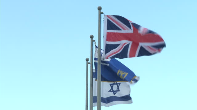 Exterior shots of Israeli Star of David and British Union Jack flags flying outside the Knesset on 13 February 2017 in Jerusalem Israel