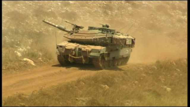 exterior shots of israeli tanks massed on israel's border near lebanon during the 2006 conflict between israel and hizbollah on july 22 2006 in... - hezbollah stock videos & royalty-free footage