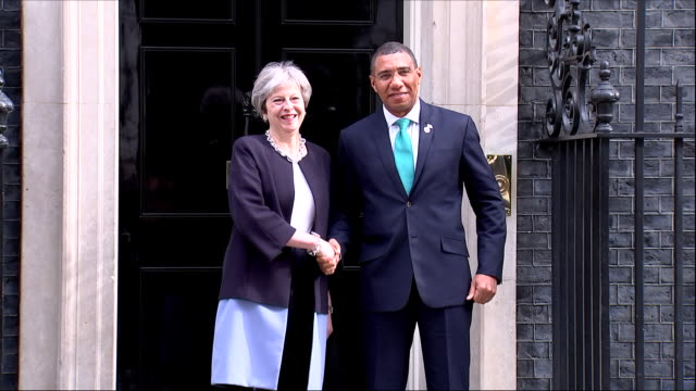 exterior shots of jamaican prime minister andrew holness arriving at 10 downing street and is greeted at front door by british prime minister theresa... - 10 downing street stock videos and b-roll footage
