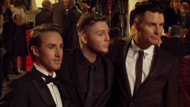 exterior shots of james arthur kye sones rylan clarke jahmene douglas and christopher maloney posing for photos on red carpet of skyfall james bond... - skyfall 2012 film stock videos and b-roll footage