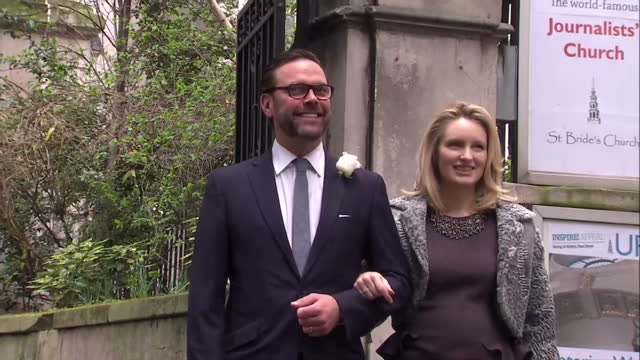 exterior shots of james murdoch and wife kathryn hufschmid pose for photo op before entering st brides church for the wedding of rupert murdoch and... - rupert murdoch stock videos and b-roll footage