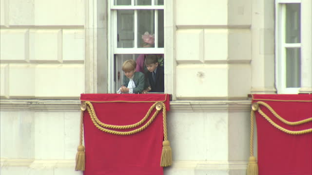 exterior shots of james viscount severn watching out of a window as members of the royal family arrive for the trooping of the colour>> on june 13... - james viscount severn stock videos and b-roll footage