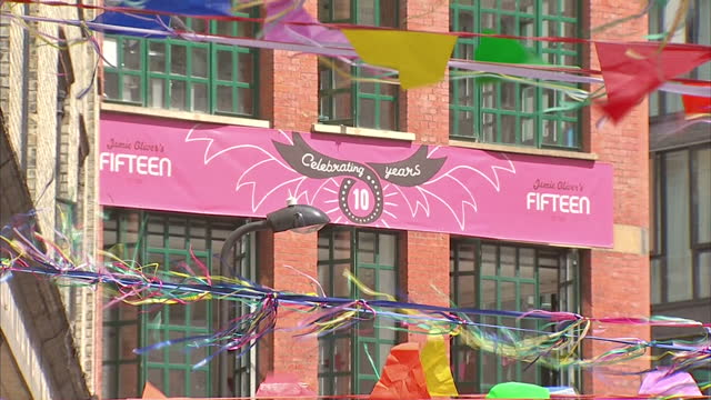 exterior shots of jamie oliver & his apprentices at a food festival celebrating the 15th anniversary of jamie oliver's restaurant called fifteen.... - jamie oliver stock videos & royalty-free footage