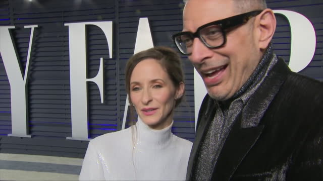 exterior shots of jeff goldblum commenting on the oscars accompanied by emilie livingston von the red carpet of the 2019 vanity fair oscar party on... - vanity fair oscar party stock videos & royalty-free footage