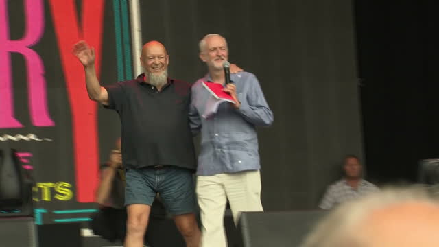 Exterior shots of Jeremy Corbyn supporters in the crowds at Glastonbury before Corbyn is introduced onto stage by organiser Michael Eavis on 24 June...