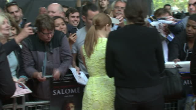 Exterior shots of Jessica Chastain signing autographs on the red carpet for the film premiere of Salome and Wild Salome at BFI Southbank on September...