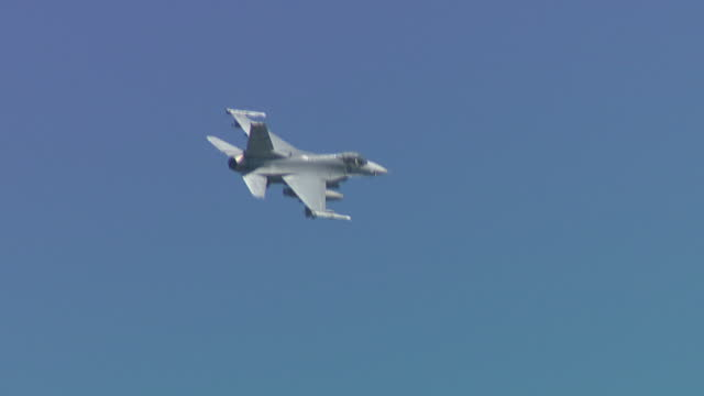 exterior shots of jets flying overhead and armoured vehicles advancing across the rodriguez range in pocheon during a south koreanus joint milatary... - militärmanöver stock-videos und b-roll-filmmaterial