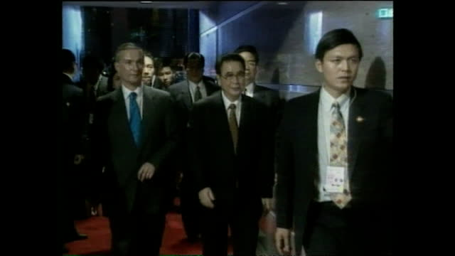 Exterior shots of Jiang Zemin President of the People's republic of China walking from car upon arrival at banquet at the handover ceremony of Hong...