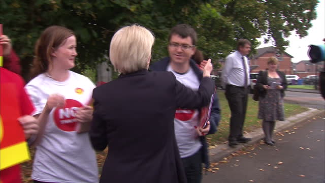 """vídeos de stock e filmes b-roll de exterior shots of joanne lamont, leader of the scottish labour party, meeting labour """"i'm voting no"""" campaign supporters on a campaign trail on... - 2014"""