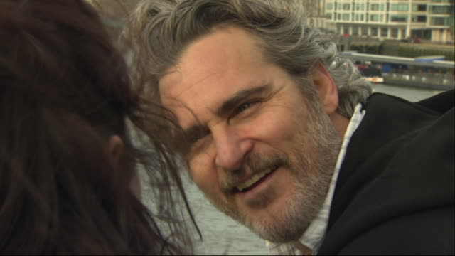 exterior shots of joaquin phoenix at climate change protest on 2nd february 2020 in london, england. - ホアキン・フェニックス点の映像素材/bロール