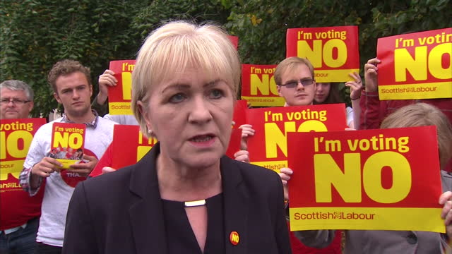 vídeos de stock e filmes b-roll de exterior shots of johann lamont being interviewed on her campaign trail, talking about why voters should vote no in the scottish referendum, and how... - 2014