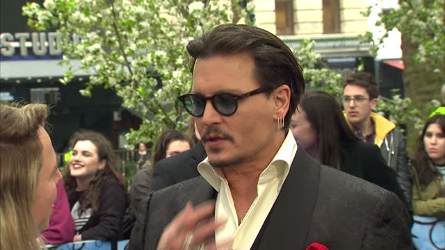 Exterior shots of Johnny Depp speaking to press on the red carpet at the European Premiere of Alice Through The Looking Glass on May 10 2016 in...
