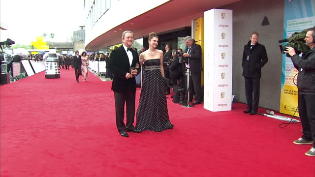 Exterior shots of Jon Culshaw and wife pose for photos on red carpet of BAFTA awards Jon Culshaw on red carpet at BAFTA Awards at The Royal Festival...