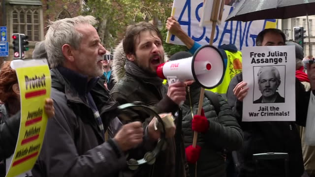 exterior shots of julian assange supporters protesting his possible extradition outside of court ahead of his hearing on 21 october 2019 in london... - whistleblower human role stock videos & royalty-free footage