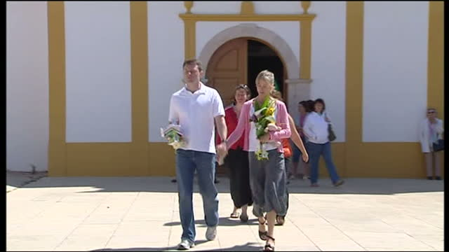 exterior shots of kate and gerry mccann, parents of missing madeleine mccann, walking from church on 27 may 2007 in praia da luz, portugal - kate mccann stock-videos und b-roll-filmmaterial