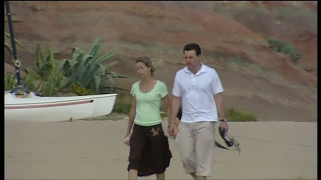 Exterior shots of Kate and Gerry McCann walking on a beach in Portugal after the disappearance of their daughter Madeleine on May 13 2007 in Lisbon...