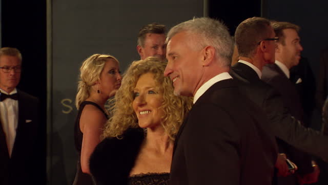 exterior shots of kelly hoppen and john gardiner attending the royal world premiere of 'spectre' at royal albert hall on october 26 2015 in london... - spectre 2015 film stock videos and b-roll footage