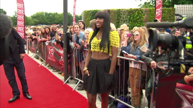 exterior shots of kelly rowland, destiny's child, new judge arriving for x factor first auditions in birmingham posing for cameras and talk to press... - destiny's child stock-videos und b-roll-filmmaterial